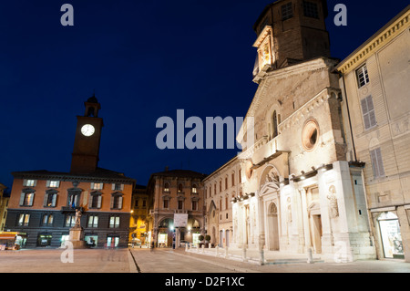 night view of Cathedral, historic buildings and main square in Reggio Emilia, north of Italy - Stock Photo
