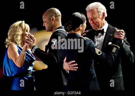 US Vice President Joe Biden dances with Army Staff Sgt  Keesha Dentino and his wife Dr. Jill Biden dances with Navy - Stock Photo