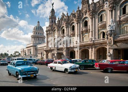 Classic 1950's American Car Passing The Capitolio Building and Gran Teatro de la Habana, Paseo de Marti, Havana, - Stock Photo