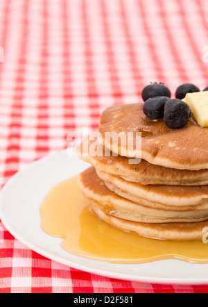 Fresh pancakes with blueberries, maple syrup and melting butter - Stock Photo