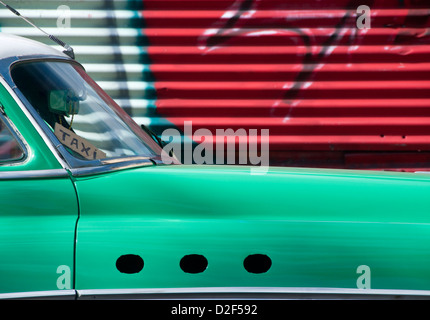 Classic American 1950's Car being used as a Taxi with Graffiti Background, Havana, Havana, Cuba - Stock Photo