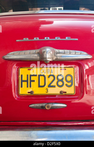 Cuban License Plate on the boot of an Old American Red Dodge Car, Havana, Cuba - Stock Photo