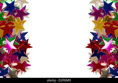 Christmas decoration of colored confetti stars against white background - Stock Photo