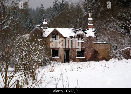 Runied cottage silhouetted in the snow at Blaize Bailey in the Forest of Dean, Gloucestershire, UK - Stock Photo