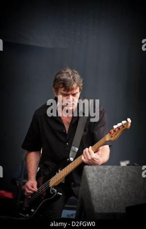 Bass Guitarist  JEAN-JACQUES BURNEL of the Stranglers on stage at V Festival Essex UK - Stock Photo