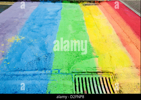 Section of road in Brighton painted in rainbow colours in celebration of Gay Pride 1st September 2012 - Stock Photo