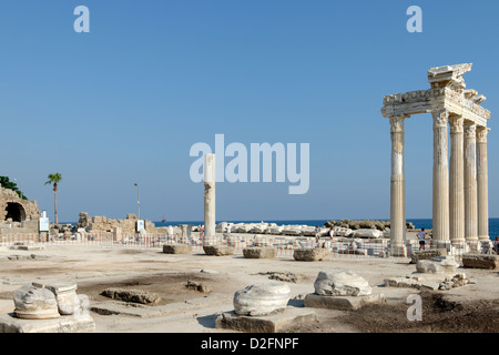Side. Antalya. Turkey. View of the ruins of the Temple of Athena and the restored columns of the Temple of Apollo - Stock Photo
