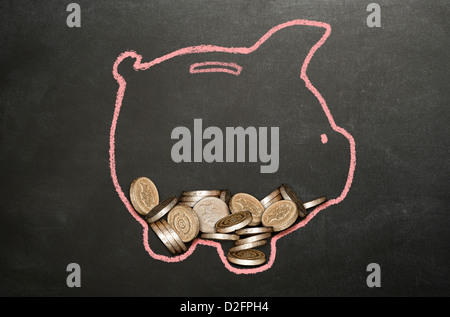 Money (sterling) coins in a piggy bank drawn on a blackboard - Stock Photo