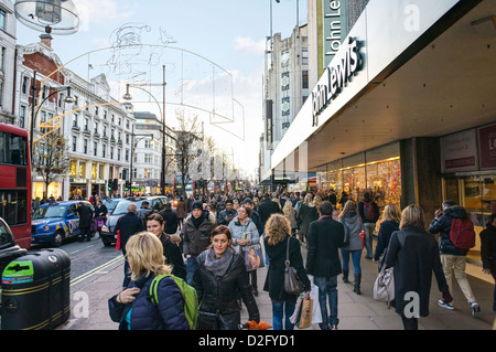 Shopping on a busy London street, Oxford Street, London at Christmas, UK - Stock Photo