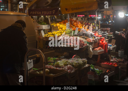 A 24 hour fruit and vegetable stand in the Chelsea neighborhood of New York - Stock Photo
