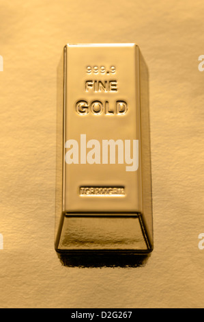 Gold Bar on a gold background - Stock Photo
