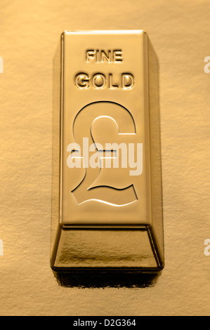 Gold Bar With A Sterling Pound Symbol Embossed On It On A Gold Stock