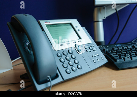 VoIP Voice over IP on the screen with a blur background of