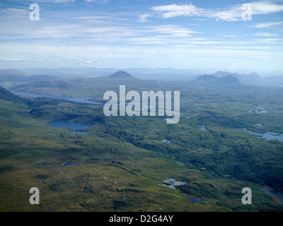 A panoramic view over the wilds of Sutherland, Loch Assynt, Canisp and Ben Mor Assynt, North West Scotland on the - Stock Photo