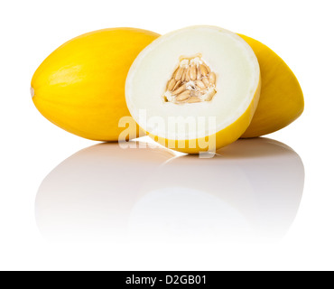 Two honeydew melons on white background. One sliced in half and second whole, copy space - Stock Photo