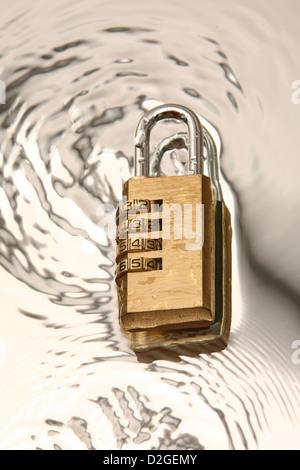 combination padlock on water - Stock Photo