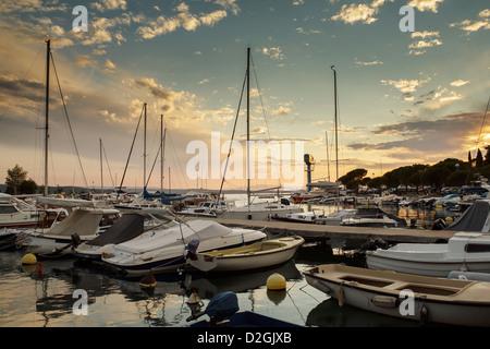 Fishing and cruise boats in Adriatic sea Croatia popular tourist destination - Stock Photo