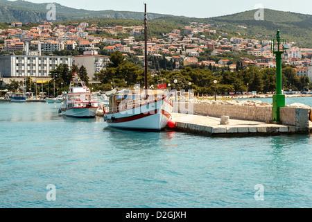 two cruise boats on pier in croatian sea - Stock Photo