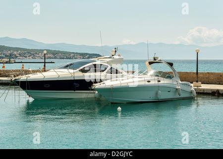 two luxury yachts on pier in croatian sea - Stock Photo