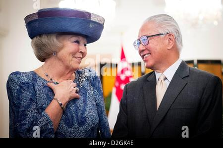 Queen Beatrix of the Netherlands is welcomed by President Tony Tan Keng Yam (R) of Singapore at the Istana Palace - Stock Photo