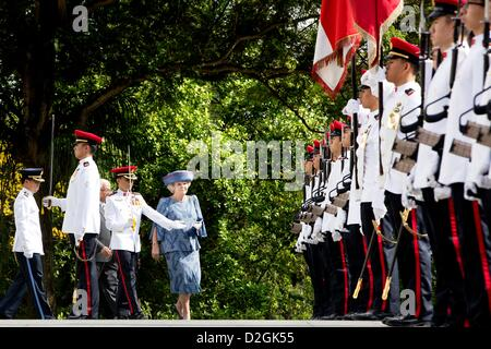 Queen Beatrix of the Netherlands is welcomed by President Tony Tan Keng Yam (HIDDEN) of Singapore at the Istana - Stock Photo