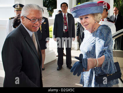 Queen Beatrix of the Netherlands is welcomed by President Tony Tan Keng Yam (L) of Singapore at the Istana Palace - Stock Photo