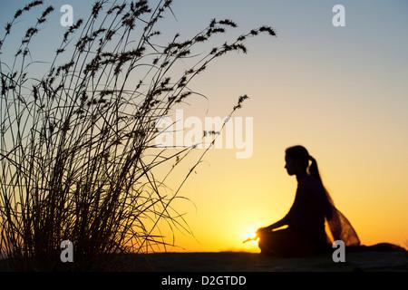 Sunset Silhouette Of An Indian Man Meditating. Andhra Pradesh ...