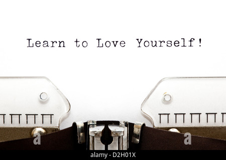 Learn To Love Yourself printed on an old typewriter - Stock Photo