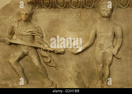 Cult statue of Apollo, standing between two torch-bearers. 175-200 AD. Marble. From the theater of Miletus. Detail. - Stock Photo