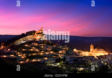 Spain, Andalusia, Montefrio, view over town at dusk - Stock Photo