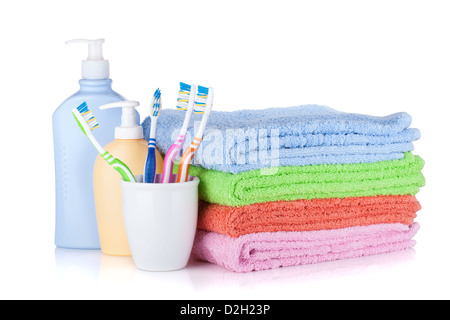 Toothbrushes, shampoo bottles and colored towels. Isolated on white background - Stock Photo