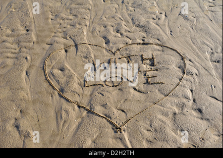 Word With Love written in sand - Stock Photo