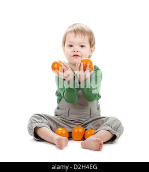 Baby with oranges. Isolated on white background - Stock Photo