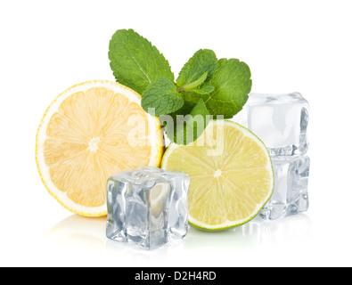Fresh lemon, lime, mint and ice cubes. Isolated on white background - Stock Photo