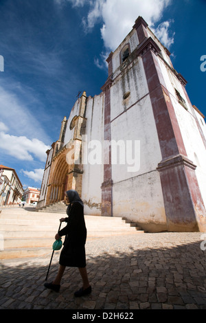 Silves, Portugal, an old woman before the Misericordia Church - Stock Photo
