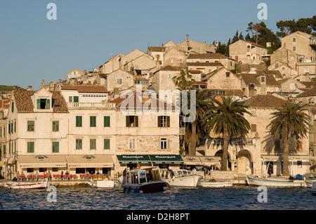 Elk192-2996 Croatia, Hvar Island, Hvar town, houses on hillside with harbor and boats - Stock Photo