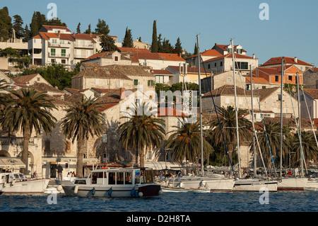 Elk192-2998 Croatia, Hvar Island, Hvar town, houses on hillside with harbor and boats - Stock Photo