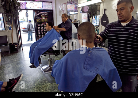young hispanic locals getting haircuts at Oaxaca barber shop ON La Cienega Blvd  in Los Angeles, USA - Stock Photo