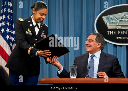Arlington, Virginia, USA. 24th January 2013. US Secretary of Defense Leon Panetta hands the signed order lifting the ban on women in combat roles during a press conference at the Pentagon January 24, 2013 in Arlington, VA.  Panetta and Dempsey discussed the new directive from the Pentagon to open all military occupations to females, removing the almost 20 year ban of women serving in combat on the front lines. Credit:  Planetpix / Alamy Live News Stock Photo