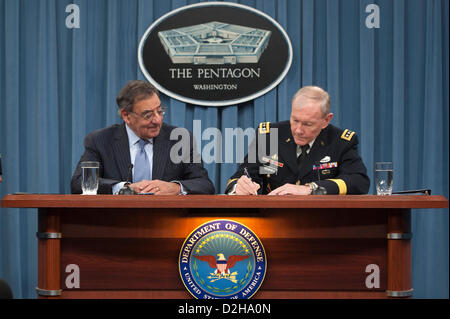 Arlington, Virginia, USA. 24th January 2013. US Secretary of Defense Leon Panetta and Joint Chiefs General Martin Dempsey sign an order lifting the ban on women in combat roles during a press conference at the Pentagon January 24, 2013 in Arlington, VA.  Panetta and Dempsey discussed the new directive from the Pentagon to open all military occupations to females, removing the almost 20 year ban of women serving in combat on the front lines. Credit:  Planetpix / Alamy Live News Stock Photo