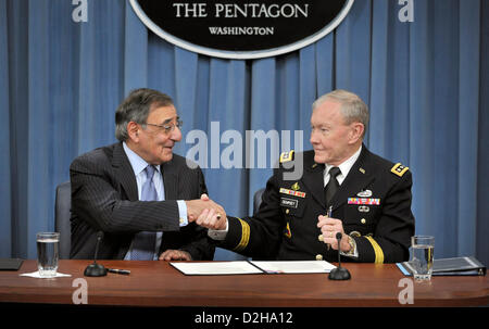 Arlington, Virginia, USA. 24th January 2013. US Secretary of Defense Leon Panetta and Joint Chiefs General Martin Dempsey shake hands after signing an order lifting the ban on women in combat roles during a press conference at the Pentagon January 24, 2013 in Arlington, VA.  Panetta and Dempsey discussed the new directive from the Pentagon to open all military occupations to females, removing the almost 20 year ban of women serving in combat on the front lines. Credit:  Planetpix / Alamy Live News Stock Photo