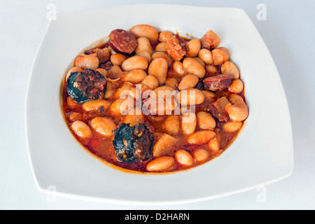 Traditional spanish bean stew native from Asturias Region. Fabada Asturiana. - Stock Photo