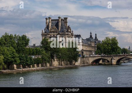 The Louvre Museum in Paris France viewed from the Seine river - Stock Photo
