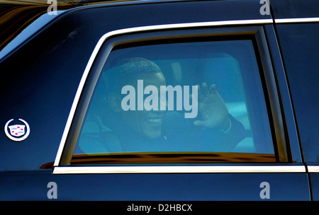 US President Barack Obama waves from his limousine window during the 57th Presidential Inauguration Parade January - Stock Photo