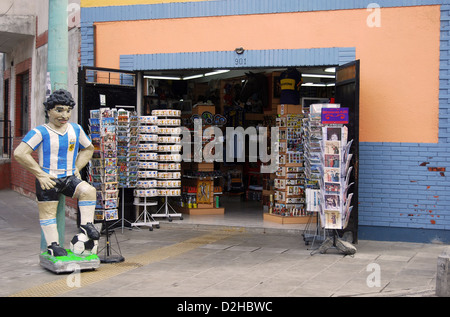 Tourist gift shop with statue of Diego Maradona in La Boca section of Buenos Aires, Argentina - Stock Photo