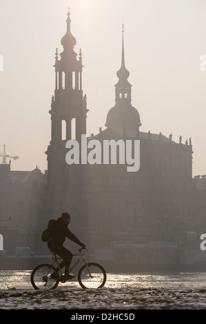 Dresden, Germany, a cyclist rides on the bike path along the Elbe - Stock Photo
