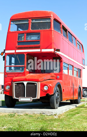 Old Unused Red London Double Decker Bus stands in a car park - Stock Photo
