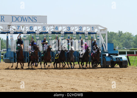 Horses at the Starting Gates. Horse Racing at River Downs track, Cincinnati, Ohio, USA. - Stock Photo