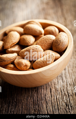 the almonds in wooden bowl - Stock Photo