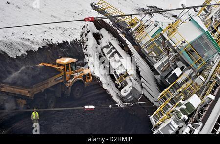 Excavators remove a lignite  hill under a bucket excavator at the opencast 'Vereinigtes Schleenhain' near Deutzen, - Stock Photo